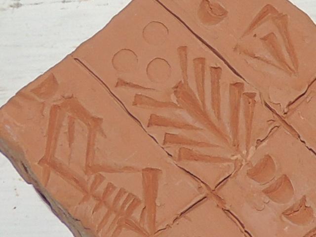 Écriture cuneiforme .